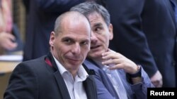 Greek Finance Minister Yanis Varoufakis (L) and Euclid Tsakalotos, Chief Economics spokesman of the Greek government attend a Eurozone finance ministers emergency meeting in Brussels, Belgium, June 24, 2015.