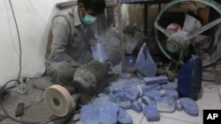 An Afghan man works at a lapis lazuli factory in the city of Kabul, Afghanistan. An international anti-corruption watchdog says Afghanistan's war is being fueled by the country's mining sector, with the Taliban earning up to $20 million a year from illegal mining of lapis lazuli on March 28, 2016.