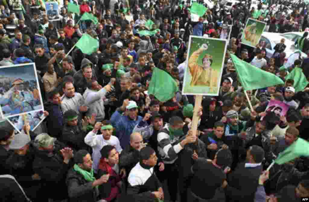 Pro-Gadhafi supporters gather in Green Square after traditional Friday prayers in Tripoli, Libya, Friday, Feb. 18, 2011. Protesters battled with security forces for control of neighborhoods Friday in eastern Libya where dozens have reportedly been killed
