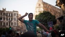 An Egyptian man chants slogans against Egyptian President Mohammed Morsi during a spontaneous anti-Muslim Brotherhood demonstration near Tahrir Square, in downtown Cairo, Egypt, June 21, 2013.