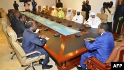Burkina Faso President Blaire Compaore (R), the top mediator in Mali's crisis, and his delegation meet at the presidential palace in Ouagadougou with rebel leaders (R) from the Islamist Ansar Dine, one of the groups controlling the country's north, June 1