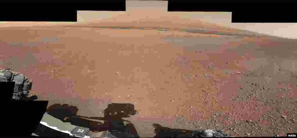 This color panorama shows a 360-degree view of the landing site of NASA's Curiosity rover, including the highest part of Mount Sharp visible to the rover. That part of Mount Sharp is approximately 12 miles (20 km) away from the rover.