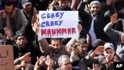 Libyan protesters demonstrate against Libyan Leader Moammar Gadhafi, in Tobruk, Libya, on Wednesday. (AP/Hussein Malla)