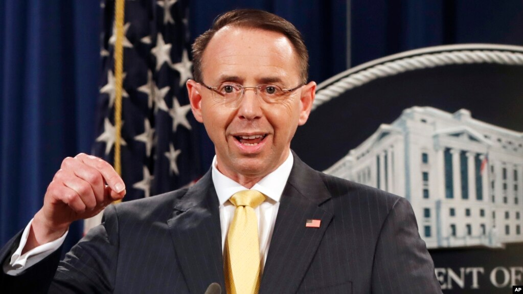 Deputy Attorney General Rod Rosenstein announces that a grand jury has charged 13 Russian nationals and several Russian entities, Feb. 16, 2018, in Washington. The defendants are accused of violating U.S. criminal laws to interfere with American elections and the political process.