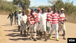 Prisoners are seen at Chikurubi Maximum Security Prison in Harare where the seven detained activists are being held on treason charges, June 3, 2019. (C. Mavhunga/VOA)