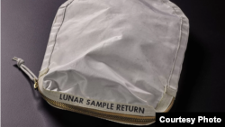 A bag carried by Apollo 11 astronauts and used to collect moon-rock samples is going up for auction. (Sotheby's)