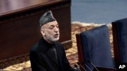 FILE - Afghan President Hamid Karzai speaks during the first day of the Loya Jirga in Kabul, Afghanistan, Nov. 21, 2013.