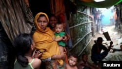 FILE - Rohingya refugees are seen outside their makeshift tent in the Kutupalong camp, Cox's Bazar, Bangladesh, Aug. 24, 2018.