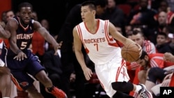 Houston Rockets' Jeremy Lin (7) drives the ball around Atlanta Hawks' DeMarre Carroll (5) in the first quarter of an NBA basketball game on Nov. 27, 2013, in Houston, Texas.