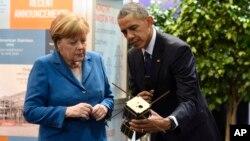 Барак Обама и Ангела Меркель на Ганноверской ярмарке.