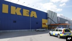A police vehicle is seen near the entrance of the IKEA store in Vasteras, Sweden, Aug. 10, 2015, after a knife attack at the store.