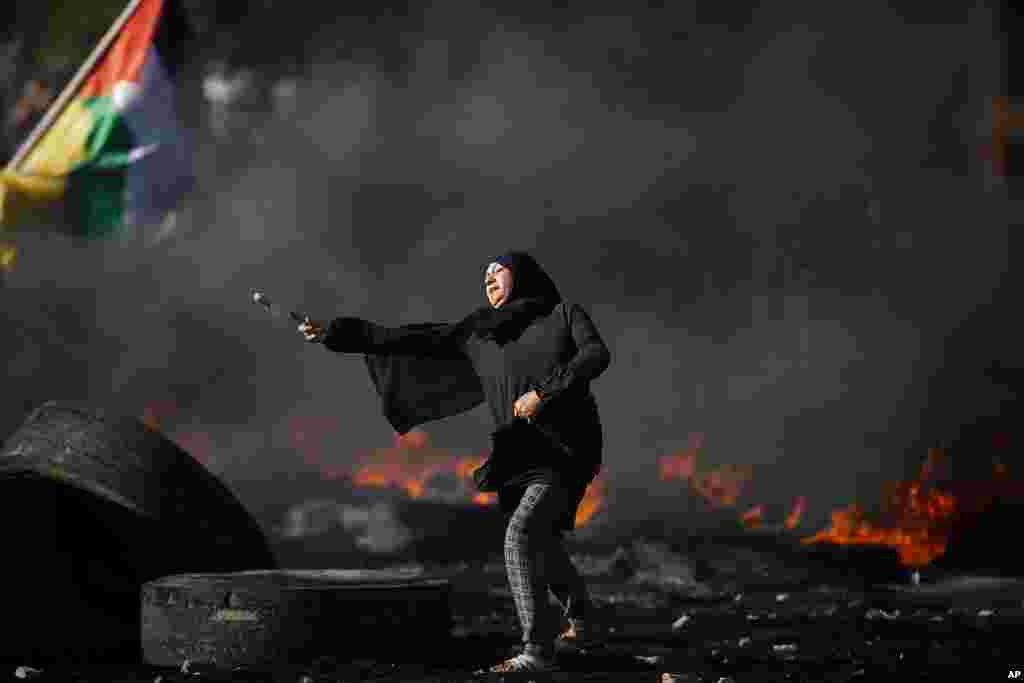 Palestinians clash with Israeli forces at the Hawara checkpoint, south of the West Bank city of Nablus.