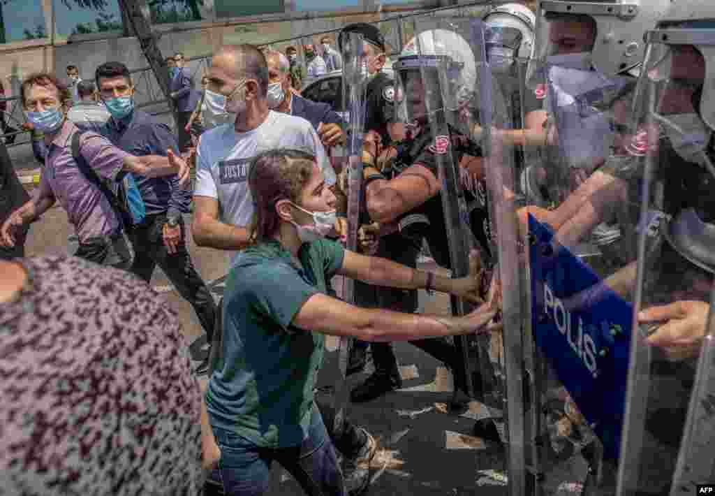 "Demonstrators clash with Turkish riot police during a ""March for Democracy"" called by Republican People's Party (HDP), after three opposition MPs were revoked and sent to prison at Silivri, in Istanbul, Turkey."