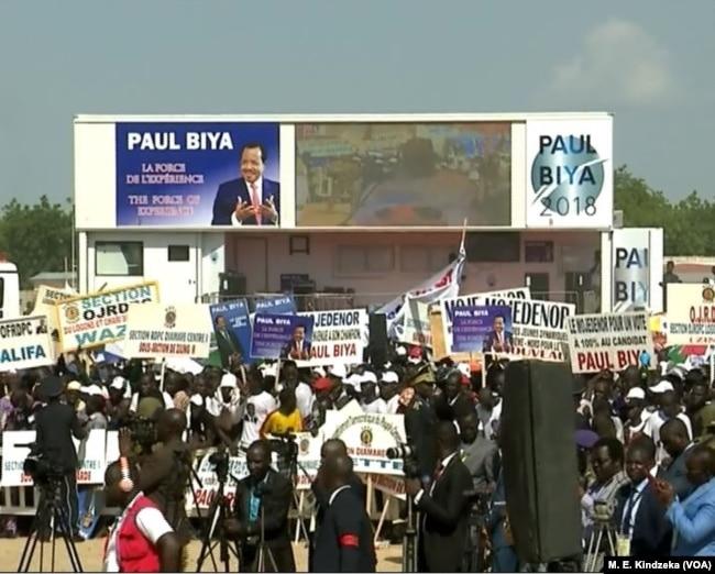 People listening to President Biya's address.