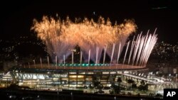 Fireworks explode above the Maracana stadium during the rehearsal of the opening ceremony of the Olympic Games in Rio de Janeiro, Brazil, July 31, 2016.