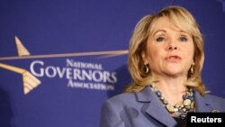 FILE - Oklahoma Republican Governor Mary Fallin speaks before the opening of the National Governors Association Winter Meeting in Washington, Feb. 22, 2014. Fallin vetoed abortion legislation in her state Friday, saying it would not withstand a court challenge.