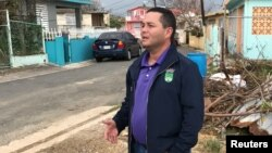 Angel Perez, the mayor of suburban Guaynabo, Puerto Rico, assesses Hurricane Maria's damage in the Vietnam section of Guaynabo, Puerto Rico, Oct. 1, 2017.