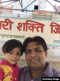 A selfie of Sunil Jaglan head of Bibipur village, with his 3 1/2 year-old daughter -- the first photo in the SelfieWithDaughter campaign (Courtesy Image/Sunil Jaglan).