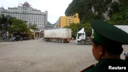 A guard monitors container trucks crossing the Tan Thanh border gate with China in Vietnam's northern Lang Son province, July 30, 2014.