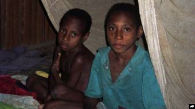 FILE – Mosquito nets helped control malaria after an outbreak in the late 1990s. Today, a mysterious illness initially thought to be malaria has hit Papua, killing at least 41 children within three weeks.