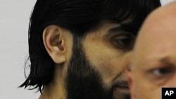 FILE - In his July 15, 2008 file photo, Rafik Mohamad Yousef enters the dock at the Higher Regional Court in Stuttgart, Germany. German prosecutors said the known Islamic extremist was shot and killed by police after he attacked an officer with a knife in
