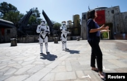 "Margaret Kerrison, managing story editor at Disney Imagineering, is interviewed at ""Star Wars: Galaxy's Edge"" during a media preview event at Disneyland Park in Anaheim, California, U.S., May 29, 2019. REUTERS/Mario Anzuoni"
