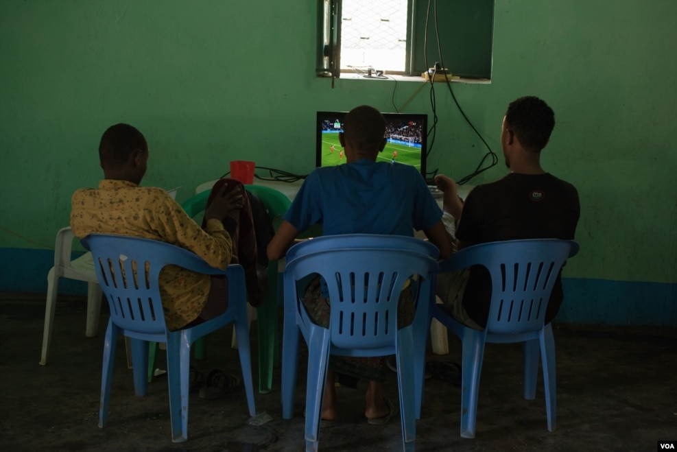 Former Al-Shabab members watch a football match at a rehabilitation center for former militants in Baidoa, Somalia, Sept. 17, 2016. (Photo: J. Patinkin/VOA)