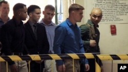 FILE - U.S. Marine Pfc. Joseph Scott Pemberton, third left, the suspect in the killing of Filipino transgender Jennifer Laude, is escorted into the courtroom for his scheduled trial, March 23, 2015, at Olongapo city, Zambales province, northwest of Manila.