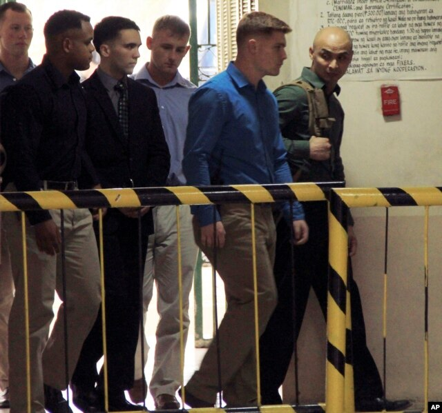 FILE - U.S. Marine Pfc. Joseph Scott Pemberton, third left, is escorted into the courtroom for his scheduled trial, March 23, 2015, at Olongapo city, Zambales province, northwest of Manila, Philippines.