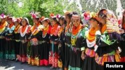 کیلاش قبیلے کے تین روزہ تہوار کے اختتام پر ہونے والی تقریب کا ایک منظر۔ فائل فوٹو