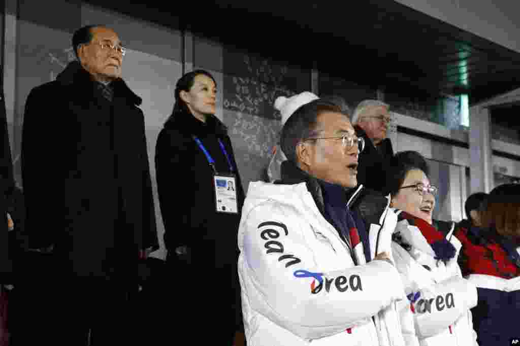 South Korean President Moon Jae-in, second from bottom right, stands alongside first lady Kim Jung-sook as the South Korean national anthem is played at the opening ceremony of the 2018 Winter Olympics in Pyeongchang, South Korea, Feb. 9, 2018.