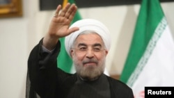 Iran's newly-elected president Hassan Rouhani is seen gesturing to the media during a news conference in Tehran in this June 17, 2013, file photo.