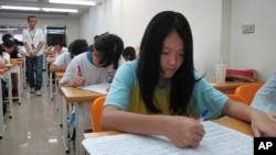 FILE - Junior high students study in a small cram school in hopes of success on their high school entrance exams, in Taipei, Taiwan.