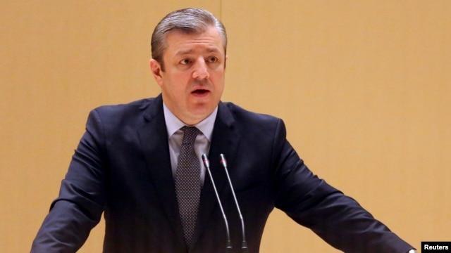 Georgy Kvirikashvili delivers a speech to members of parliamentary groups and committees in Kutaisi, Georgia, Dec. 28, 2015.