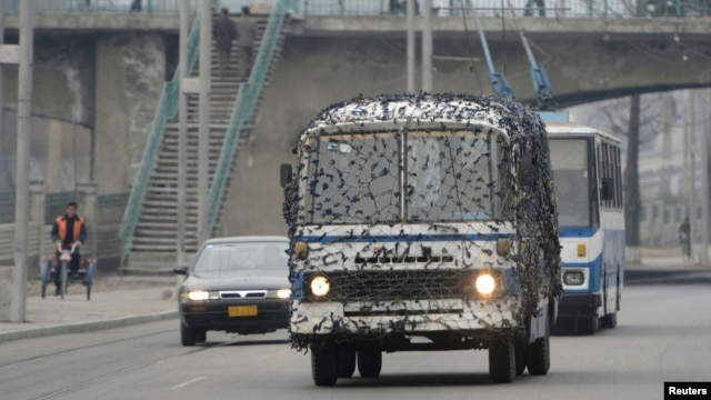 A bus covered in a net-like object drives on a street in Pyongyang, North Korea, in this photo taken by Kyodo, March 6, 2013.