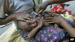 An ethnic Kachin child suffering from malaria receives treatment at a camp for people displaced by fighting between government troops and the Kachin Independence Army in northern Burma, February 22, 2012.