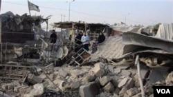 Serangkaian serangan bom di ibukota Irak hari Kamis menewaskan lebih dari 60 orang (22/12).