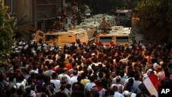 Egyptian protesters gather in front of the Israeli embassy in Cairo, Egypt, August 20, 2011.