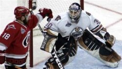 **CORRECTS BYLINE**Carolina Hurricanes' Mark Recchi (18) knocks down the puck as Edmonton Oilers goaltender Jussi Markkanen, of Finland, watches in the second period during Game 2 of the Stanley Cup hockey finals Wednesday, June 7, 2006 in Raleigh, N.C. (