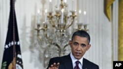 Shugaban Amurka Barack Obama yana masa tambayoyi a taron manema labarai,
