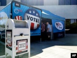 FILE - Idaho voters head to a new food truck-inspired voting unit in Boise, Idaho on Sept. 27, 2016.