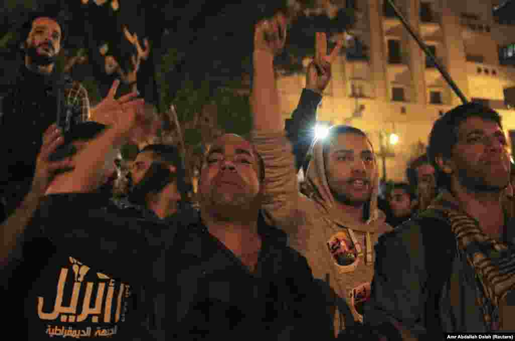 Activists and anti-government protesters shout slogans against the military and interior ministry during a rally against a new law restricting demonstrations, in front of Egypt's Parliament in Cairo November 27, 2013.