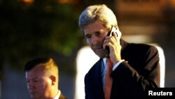 U.S. Secretary of State John Kerry speaks on the phone after a round of Syria talks in Lausanne, Switzerland, Oct. 15, 2016.