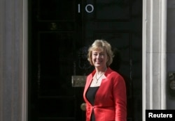 FILE - Andrea Leadsom arrives at 10 Downing Street as Britain's re-elected Prime Minister David Cameron names his new Cabinet, in central London, Britain, May 11, 2015. Energy Minister Leadsom is a leading candidates to replace David Cameron as leader of