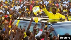 FILE - Uganda's president and presidential candidate Yoweri Museveni of the ruling party National Resistance Movement waves to his supporters as he arrives at a campaign rally in Entebbe, Uganda, Feb. 10, 2016.