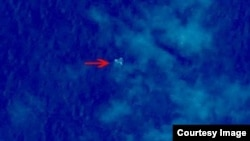 Debris from what could be Malaysian Airlines flight MH370 is seen in this satellite image from China's State Administration for Science, Technology and Industry for National Defense.