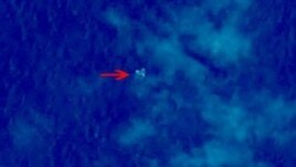 Debris from what could be Malaysian Airlines flight 330 is seen in this satellite image from China's State Administration for Science, Technology and Industry for National Defense.
