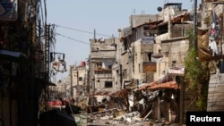 A general view shows buildings that were damaged during clashes between with forces loyal to Syria's President Bashar al-Assad and Free Syrian Army fighters, near Sayeda Zainab area in Damascus, May 27, 2013.