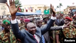 Michel Djotodia greets supporters at a Seleka rebel rally in Bangui, Mar. 30, 2013.