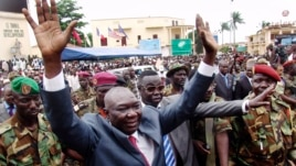 Central African Republic's new leader Michel Djotodia greets supporters at a Seleka rebel alliance rally, downtown Bangui, March 30, 2013.